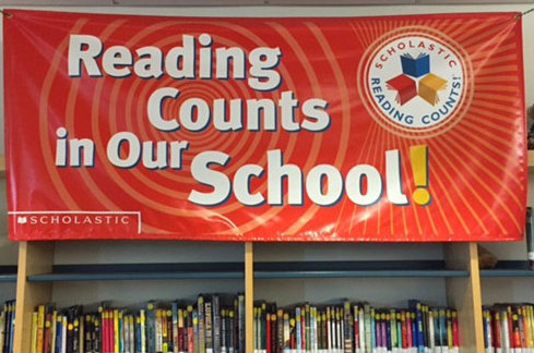 """Readung counts in our school"" banner"